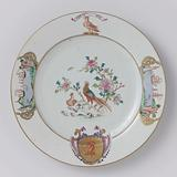 Plate with two pheasants on a rock near flowering plants and the arms of the Munro family