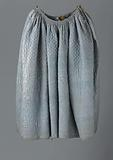 Skirt with side slits and brown linen lining in blue, quilted and quilted silk, with a diamond pattern at the top and …
