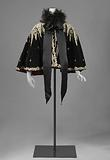 Cape with small dots and rosettes