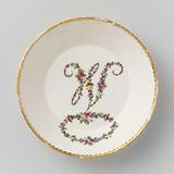 Saucer, painted with the letter M, formed from a flower garland