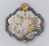 Plate, diamond-shaped with a bulging edge with four shells, multicoloured painted with a Chinese garden with birds
