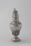 Silver sugar sprinkler, inverted pear-shaped on arched base and with twisted openwork cap, decorated with seed beads, …