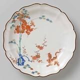 Lobed dish with dragon, tiger, bamboo and prunus