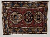 Carpet with three medallions on red ground filled with geometric figures. Three edges..
