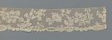 Strip of bobbin lace with forget-me-nots and two composite branches