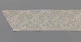 Strip bobbin lace with two candelabra motifs