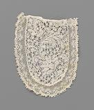 Jabot of bobbin lace with a wave of a fan-shaped flower and feathered leaves