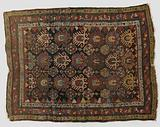 Palmette rug with repetitive pattern of stylized lotus flowers and volute rosettes and triangles