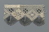 Strip bobbin lace with diamonds and dark blue fan scallops