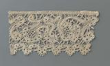 Strip of bobbin lace with a continuous winding ribbon that forms whimsical flowers