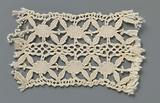 Strip bobbin lace with double row of ovals flanked by four leaves