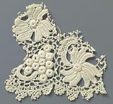 Fragment crocheted lace with flowers and bunch of grapes