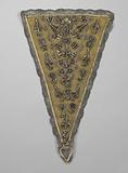 Devant-de-gorge or triangular brocade of silver brocade between yellow silk ribbons covered with silver tulle trim, …