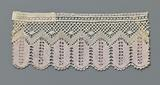 Strip lilac-white bobbin lace with hanging ears of corn