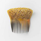 Blonde turtle hair comb with high upright carved back with graceful leaf tendrils, thirteen teeth