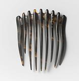 Tortoise hair comb with narrow back with a rounded pinnacle above each tooth
