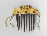 Tortoise hair comb, the back of which is decorated with a gilded copper plate with imitation pearls and rubies
