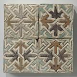 Tile, multicoloured decorated with an ornament of intertwined stars