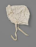 Children's hat in white muslin decorated with white work and fils tirés, and trimmed with strips of Mechelen lace