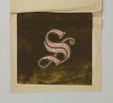 Green velvet with letter S embroidered in pink silk and gold thread with sequins