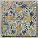 Field of four tiles that together form one rosette around which tulips, pomegranates and bunches of grapes