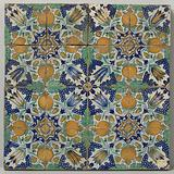 Field of sixteen tiles with a pattern of bunches of grapes, pomegranates, tulips and stars