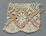 Strip bobbin lace with salmon pink diamonds