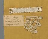 Steel bobbin lace with coarse thread as an example of a ribbon in linen stitch with a fragment of lace in which this …