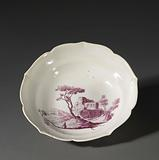Bowl with scalloped edge, painted in purple in the center with a landscape with ruins