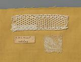 Steel bobbin lace with coarse thread as an example of a ground in netting