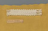 Steel bobbin lace with coarse thread as an example of a ribbon in linen stitch with decorative thread that is used in …
