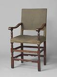 Armchair upholstered in green dull. Decorated with dental frames, among other things..
