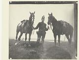 Portrait of a mounted gunner with two horses