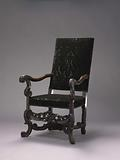 Armchair on angled front legs in the shape of broken S-scrolls, decorated with acanthus leaf