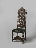Chair with upholstered seat and carved openwork back. Decoration of broken scrolls, shell motifs and acanthus leaf.