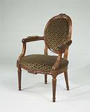 Armchair in mahogany, with conical fluted legs and on the front line decorated with a bow