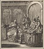 Four women at a laundry basket