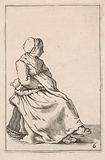 Seated woman with folded arms