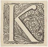 Letter K in an ornamented frame