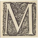 Letter M in an ornamented frame
