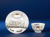 Bell-shaped cup and saucer with a port scene of Amsterdam