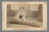 Japanese woman plays the Japanese string instrument koto
