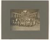 Group portrait of a music company in the Concertgebouw, Amsterdam