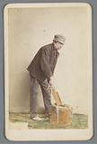 Portrait of an unknown man with a wooden block and brush