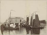 Moored sailing ships at the Orange Locks in Amsterdam