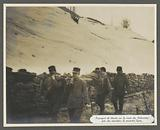 Transport of injured people by stretcher on a road in the Dolomites, probably Italians