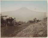 Mount Fuji seen from Otometoge, with in the foreground men and a woman with a horse