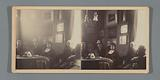 Group portrait in living room with stereoscope and photos on the table