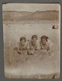 Portrait of three girls lying on the beach at Egmond aan Zee