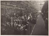 Wolseley factory interior cars with workers and wheel covers